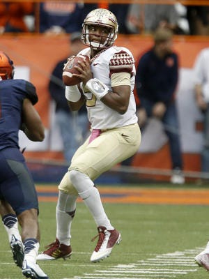 Florida State quarterback Jameis Winston drops back to pass during the Seminoles'  38-20 win over Syracuse Saturday.