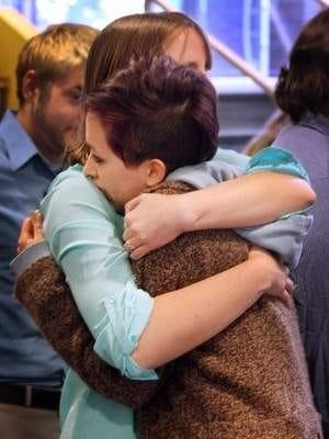 Emmie Arnold, left, a member of Vanderbilt Students of Nonviolence, hugs Vanderbilt grad Caitlin Mitchell during the demonstration in the Sarratt Student Center on Vanderbilt University's campus.