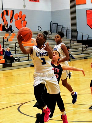 Wyoming's Ashli O'Neal powers past the New Richmond for two more points.