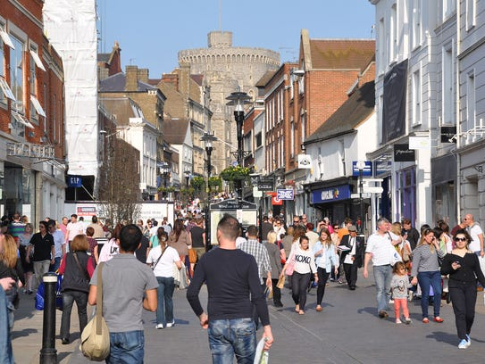Windsor Castle's ramparts loom over the town's shopping