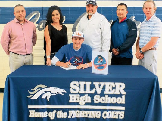 Courtesy Photo   Silver High baseball standout Zach Jasso signed with the University of Mary. Standing from left, are Silver head basebal coach Claudie Thompson, mother Sonia Flores, father Chris Jasso, Silver athletic director Victor Oaxaca, and assistant baseball coach Lee Wilson.