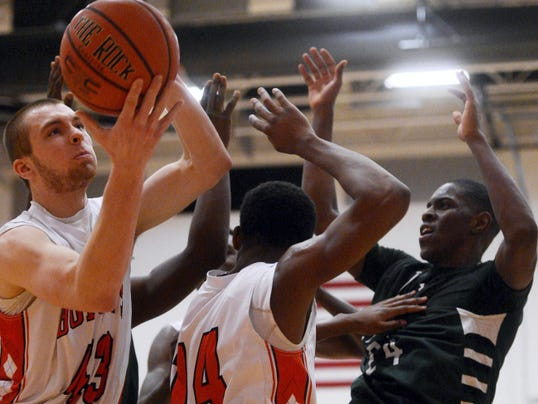 Northeastern's Derrick Hoffman grabs the rebound during the District 3 Class AAAA boys' basketball tournament first-round game Wednesday at Northeastern.