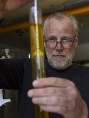 Bob Purman measures the sugar content of its new iced cider.