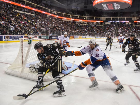Travis Boyd, of Hershey, takes the puck behind the