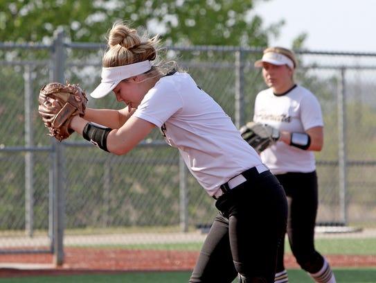 Henrietta's Haleigh Hogan pitches against Holliday
