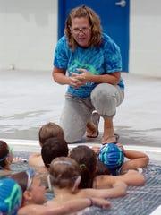 Retiring swim coach Kristi Moore started many traditions