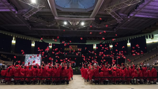 The 2016 City High graduating class tosses their caps at Carver-Hawkeye Arena. Saturday, May 21, 2016.
