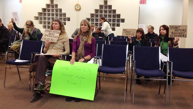 Protesters against the city's purchase of smart meters were on hand Tuesday for the Silver City Town Council meeting.