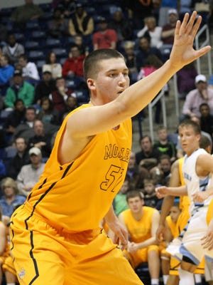 Moeller's 6-foot-9 Nate Fowler usually has a hand in someone's face.