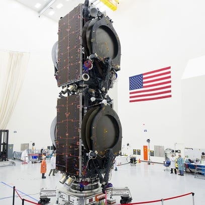Eutelsat and ABS communications satellites during processing