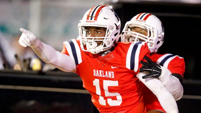 Oakland's Jeron Rooks (15) celebrates a touchdown with Justin Jefferso (6) during the second round of the play-off game against Blackman on Friday, Nov. 10, 2017, at Oakland.