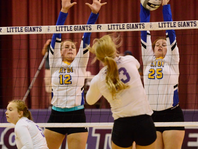 Clyde's Ruby Schabel, left, and Jackie Smith block