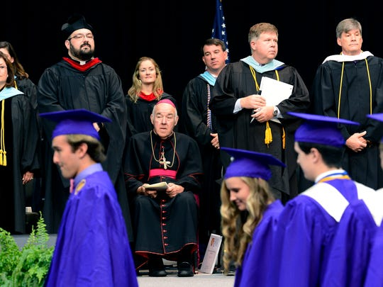 The Most Reverend David R. Choby, bishop of the Diocese of Nashville, watches as graduates take their seats during the Father Ryan High School graduation at the Belmont University Curb Event Center on Sunday, May 15, 2016, in Nashville, Tenn.