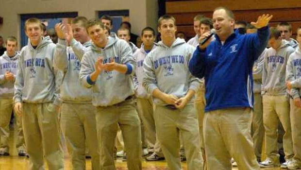 Memorial High School football coach John Hurley, with the team behind him, addresses students during a pep rally for the team on Tuesday. The fifth-ranked Tigers, in their first season under Hurley, will play Bellmont on Saturday for the Class 3A state championship in Indianapolis. Nov. 25, 2008.