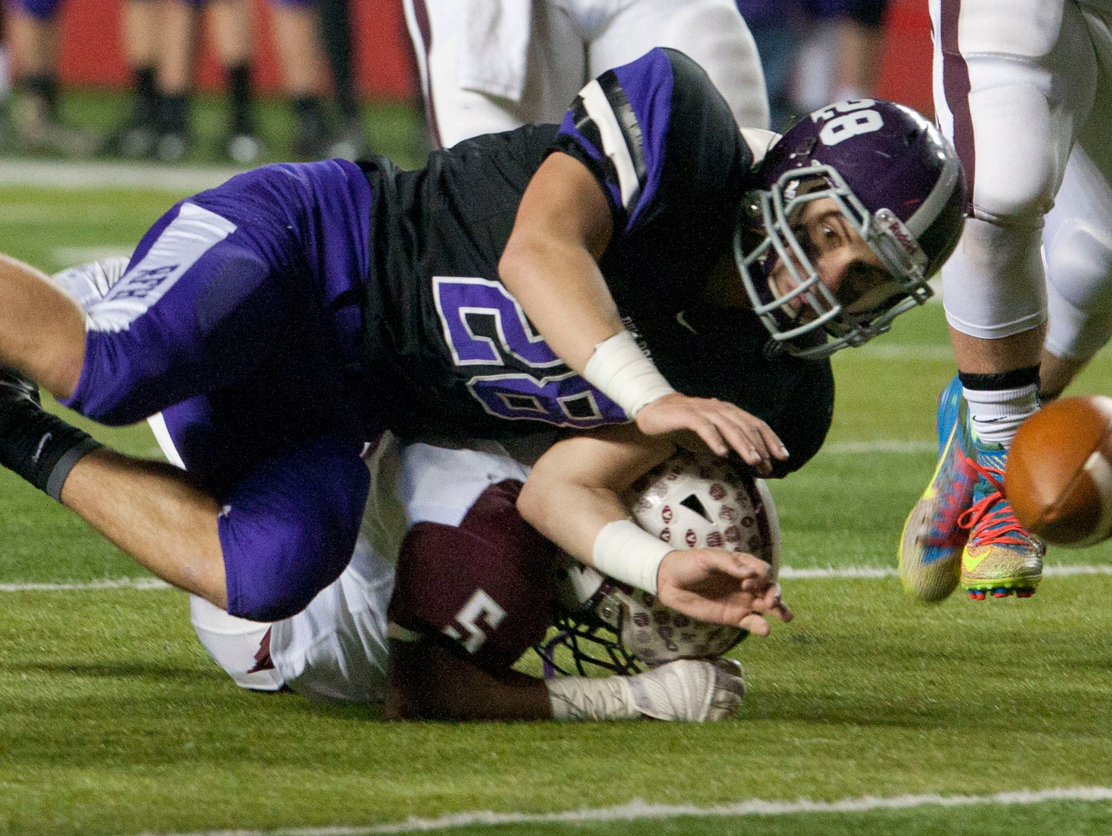 NJSIAA Group 3 state championship football Red Bank Regional vs. Rumson Rumson #28 Pat Russo dives for a ball fumbled by Red Bank #5 Alim Godsey—December 5, 2015-Rutgers, NJ.-Staff photographer/Bob Bielk/Asbury Park Press