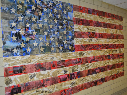 A flag created by Horseheads High School art students after the attacks of Sept. 11, 2001 hangs in the school's hallway.