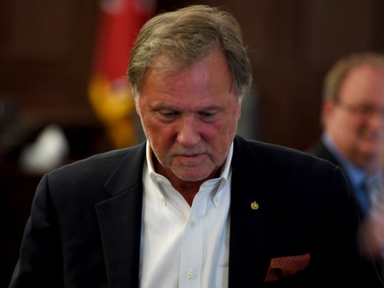 Madison County Mayor Jimmy Harris starts to walk out