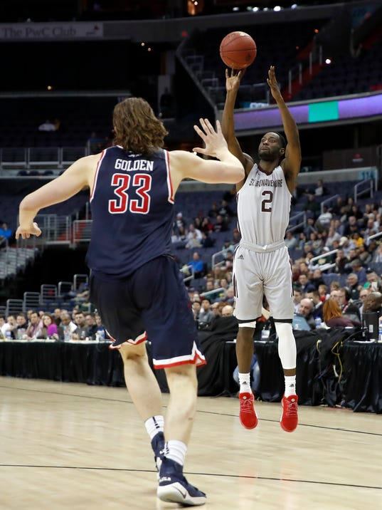 St. Bonaventure guard Matt Mobley (2) shoots a three-point basket over Richmond forward Grant Golden (33) during the second half of an NCAA college basketball quarterfinal game in the Atlantic 10 Conference tournament, Friday, March 9, 2018, in Washington. (AP Photo/Alex Brandon)
