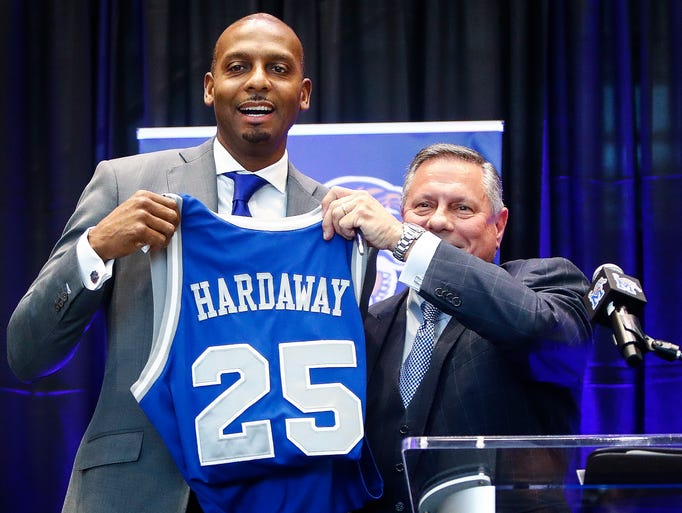 """Anfernee """"Penny"""" Hardaway holds up his old jersey with"""