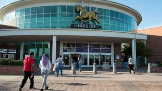 Shoppers enter Wolfchase Galleria which celebrates its 20th anniversary with an event this Saturday.