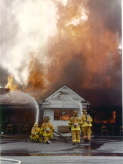 August 1993: Firefighters try unsuccessfully to save