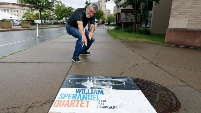 John Nugent, producer and artistic director of the Xerox Rochester International Jazz Festival has some fun on his way to one of the venues.