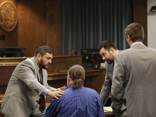 George Burch talks with his lawyers before taking the witness stand in Brown County Circuit Court on Wednesday. Burch is on trial for the 2016 murder of Nicole VanderHeyden in Ledgeview.