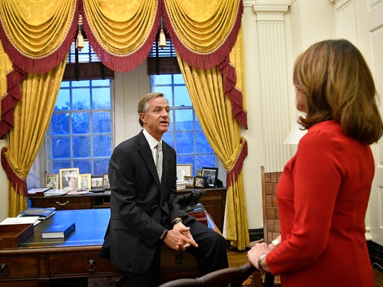 Gov. Bill Haslam talks with his wife, Crissy, in his private office before delivering his State of the State address at the state Capitol on Jan. 29, 2018.