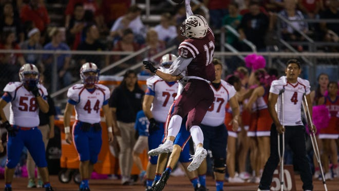 Calallen's Sam Allen jumps to defeatefelct a Gregory-Portland pass during the third quarter of their game against at Phil Danaher Stadium in Calallen on Friday, Oct. 13, 2017.