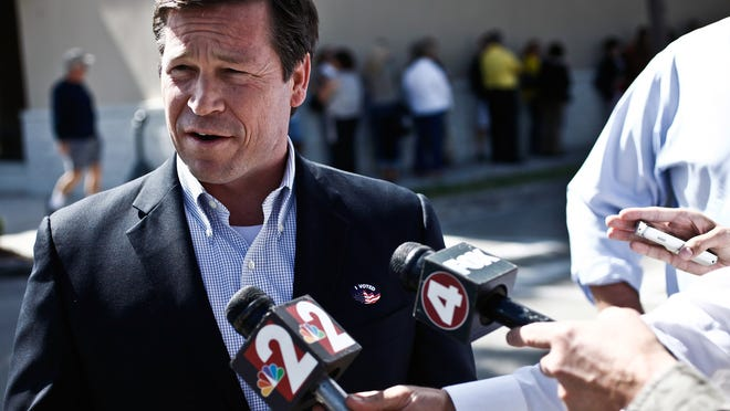 Congressman Connie Mack speaks with reporters after voting at the Lee County Elections Center in Fort Myers, Fla., on Tuesday, Oct. 30, 2012. (AP Photo/Naples Daily News, Scott McIntyre)  FORT MYERS OUT ORG XMIT: FLNAP104