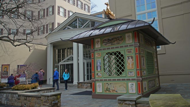 Visitors to Winterthur Museum passby the new Chinese Pavilion Folly in the new follies exhibit.