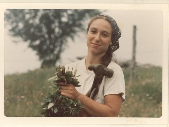 Kerry Abram picking basil in 1973 at Frog Run Farm in East Charleston. Photo by Lucy Horton from the personal collection of Mary Mathias.