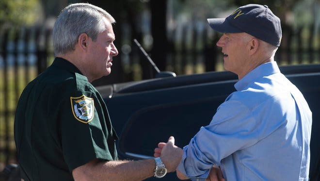 Escambia County Sheriff David Morgan, left, speaks privately with Gov. Rick Scott outside the Escambia County Emergency Operations Center Thursday, Oct. 5, 2017. The governor stopped in Pensacola to meet with local leaders and to remind residents to remain vigilant as Tropical Storm Nate approaches the Northern Gulf Coast.