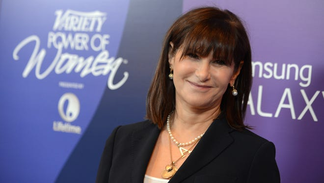 """Amy Pascal, Sony Pictures Entertainment co-chairman, arrives at Variety's 5th Annual Power of Women event on Oct. 4, 2013, in Beverly Hills, Calif. Pascal is under fire for racist remarks that surfaced in emails made public by the Sony cyberattack. Pascal apologized Thursday, Dec. 11, 2014, for the """"insensitive and inappropriate"""" comments in her emails that she says are """"not an accurate reflection of who I am."""""""