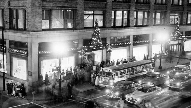 Christmas decorations at Sibley, Lindsay & Curr Co. light the way for shoppers in this 1953 photo.