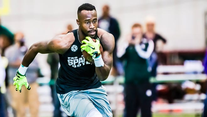 MSU wide receiver Tony Lippett runs after making a reception in a drill during MSU Football Pro Day WednesdayMarch 18, 2015 at the Duffy Daugherty Building in East Lansing.