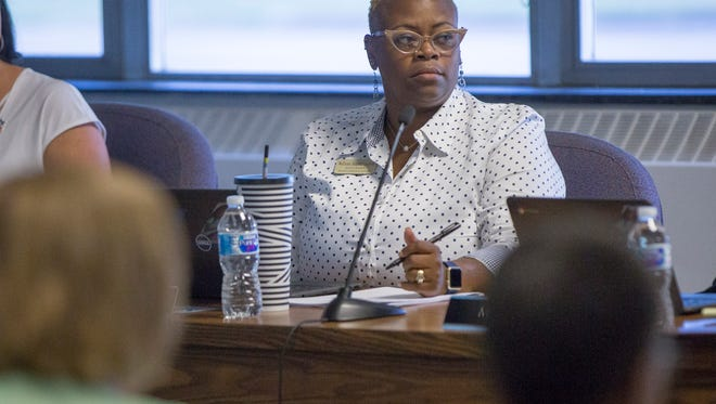 WaTasha Barnes Griffin listens to her fellow board members during the first meeting of the Ball State University appointed MCS school board on July 16 at the Muncie Area Career Center. The new members are planning to hold the monthly meetings at different locations through the year.