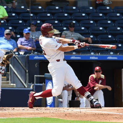 FSU junior catcher Cal Raleigh hits a double in Tuesday's