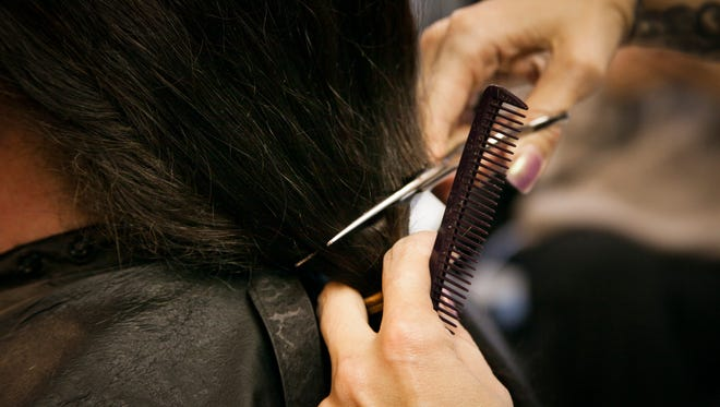 """Elizabeth """"Libby"""" Leonard, 44, prepares to donate her hair for the fourth time to help make wigs for cancer patients. Samantha Hickernell of Samantha's Styles at 911 Chestnut St. in Lebanon has cut and prepared Leonard's hair for the last two cutting sessions."""