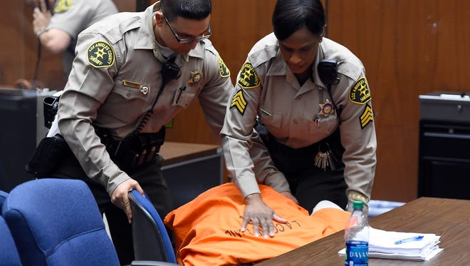 "Marion ""Suge"" Knight collapsed at a bail hearing at the Criminal Courts Building Friday in Los Angeles."