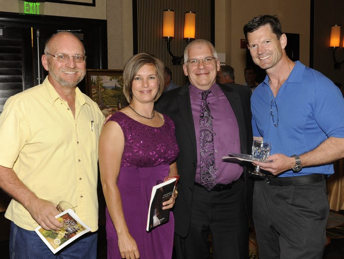 John Helzer, left, Shelley Walker, Egan Walker and Mark Covington attend the Rotary Club of Reno Centennial Sunset's Taste of Reno Tahoe Sunday June 1, 2014 at the Atlantis.