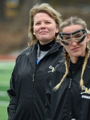 While in her first year at Marian, head coach Sherry Pifer-Elliott is well known in the lacrosse community around Bloomfield Hills.