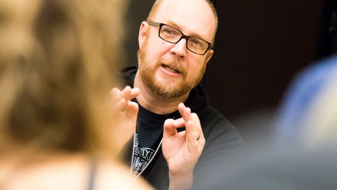 """Music director Steve Goers works with singers during a rehearsal for the College-Conservatory of Music production of """"Children of Eden,"""" which takes place March 30-April 1."""