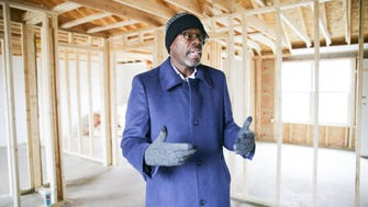Anthony Murdock, an Executive Pastor at Eastern Star Church in Indianapolis, stands inside a five bedroom home in the proces of being rehabbed on Priscilla Ave. in Indianapolis where the church has built some new homes and rehabbed others through The Rock Initiative on Monday, April 9, 2018.  The Rock Initiative is a part of the church's mission to improve the quality of life in the 46218 area through community, housing, finances, and education.