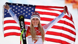 Lindsey Vonn (USA) celebrates winning the bronze medal in the downhill skiing race during the Pyeongchang 2018 Olympic Winter Games at Jeongseon Alpine Centre.