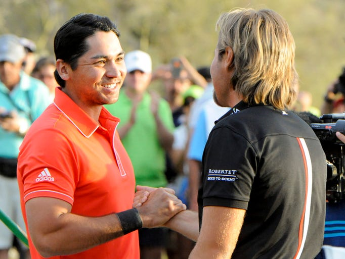 Jason Day shakes hands with Victor Dubuisson after playing the 22nd hole and winning the final round.