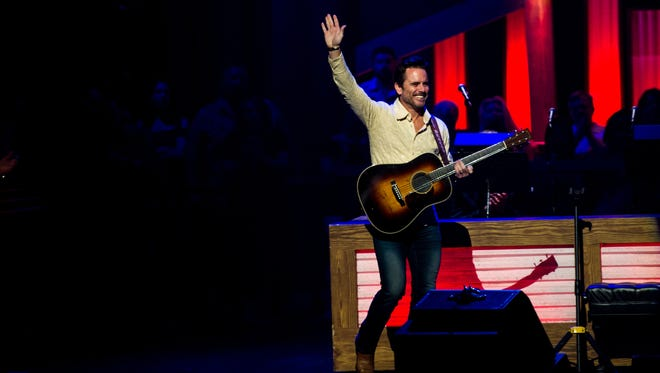 Charles Esten waves to the audience as he takes to the stage at the Grand Ole Opry in Nashville, Tenn., Saturday, July 15, 2017.