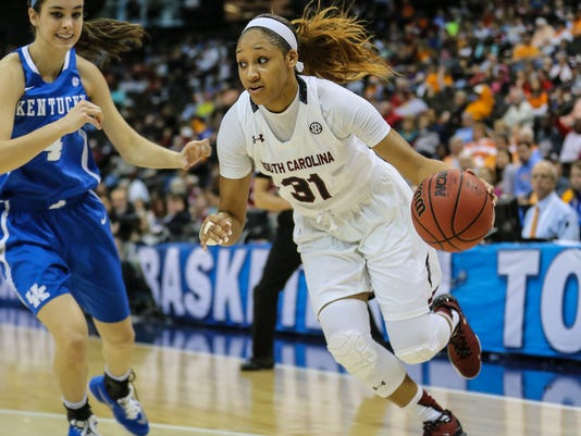South Carolina forward Asia Dozier (31) drives to the basket defended by Kentucky forward Maci Morris (4) during an NCAA college basketball game in the Southeastern Conference women's tournament semifinal in Jacksonville, Fla., Saturday, March 5, 2016. (AP Photo/Gary McCullough)