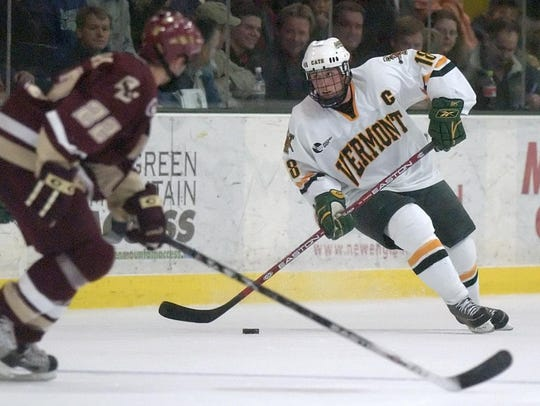 Jamie Sifers, right, skates for Vermont in a game against