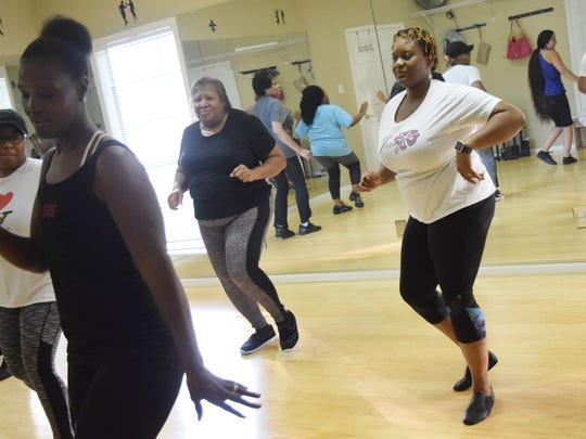 Shirley Stafford-Stanley (left), Mary McClain and Michelle Crawford learn the basics of the cha-cha at Dancing With a Twist, a new dance studio opened by Brandon and Charlene Wilkinson. The dance studio is geared towards teaching adults the basics of a wide variety of dances.